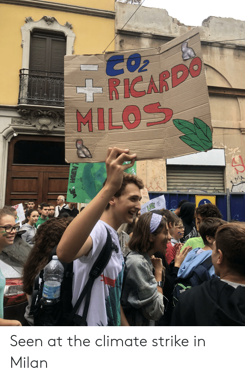 Cross, Top, and Strike: 2  RICARDO  MILOS  TOP  NG  DUR  ARTH  NOT  CROSS  YNG  CENE S  THE  aRepubbkai  2NETH Seen at the climate strike in Milan