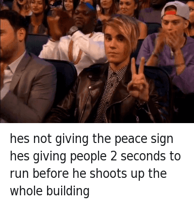 Justin Bieber, Run, and Ups: hes not giving the peace sign hes giving people 2 seconds to run before he shoots up the whole building hes not giving the peace sign hes giving people 2 seconds to run before he shoots up the whole building