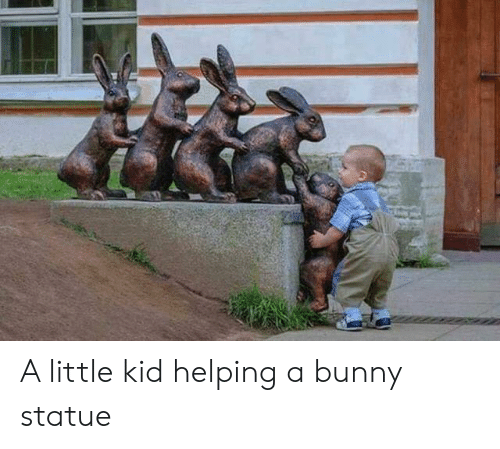 Bunny, Kid, and Helping: A little kid helping a bunny statue