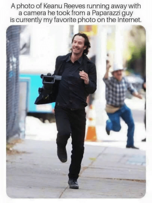 Internet, Camera, and Running: A photo of Keanu Reeves running away with  a camera he took from a Paparazzi guy  is currently my favorite photo on the Internet.