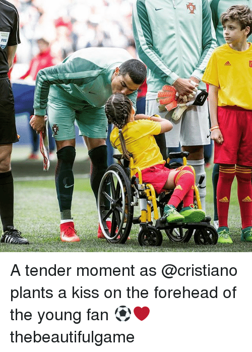 Memes, Kiss, and 🤖: A tender moment as @cristiano plants a kiss on the forehead of the young fan ⚽️❤️ thebeautifulgame