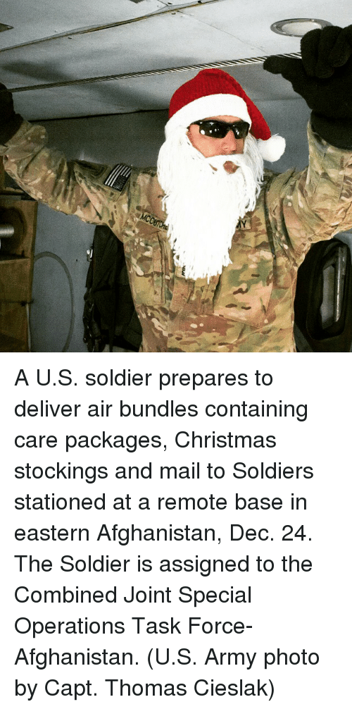 a us soldier prepares to deliver air bundles containing care