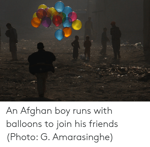 Friends, Afghan, and Boy: An Afghan boy runs with balloons to join his friends (Photo: G. Amarasinghe)