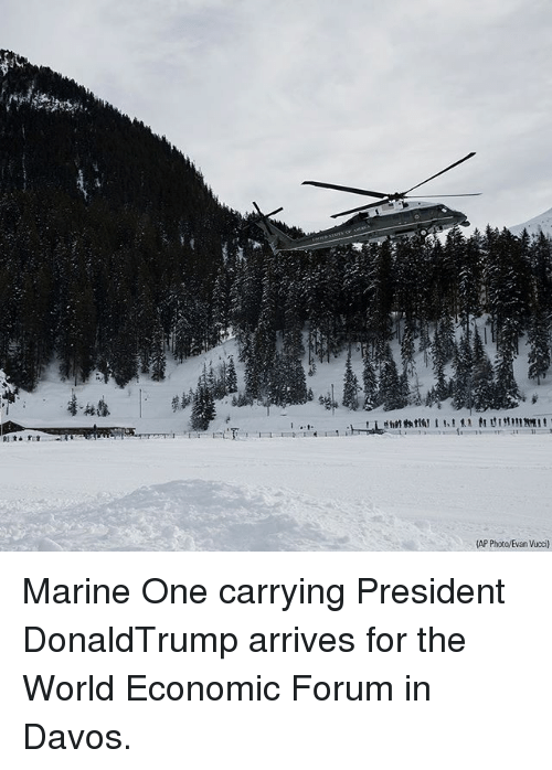 Memes, World, and 🤖: AP Photo/Evan Vucci) Marine One carrying President DonaldTrump arrives for the World Economic Forum in Davos.