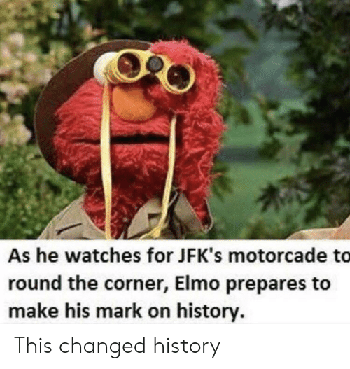 Elmo, History, and Watches: As he watches for JFK's motorcade to  round the corner, Elmo prepares to  make his mark on history. This changed history