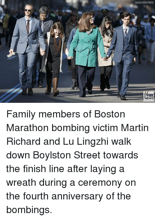 Family, Finish Line, and Martin: ASSOCIATED PRESS  FOX  NEWS Family members of Boston Marathon bombing victim Martin Richard and Lu Lingzhi walk down Boylston Street towards the finish line after laying a wreath during a ceremony on the fourth anniversary of the bombings.