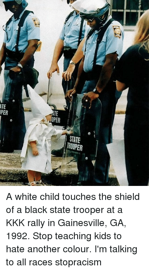ATE PER STATE a White Child Touches the Shield of a Black State