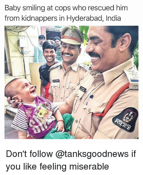 Funny, India, and Baby: Baby smiling at cops who rescued him  from kidnappers in Hyderabad, India Don't follow @tanksgoodnews if you like feeling miserable