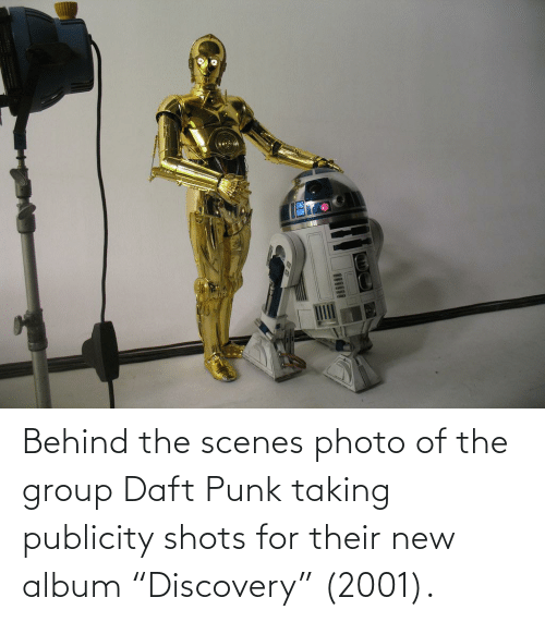"""Daft Punk, New Album, and Punk: Behind the scenes photo of the group Daft Punk taking publicity shots for their new album """"Discovery"""" (2001)."""