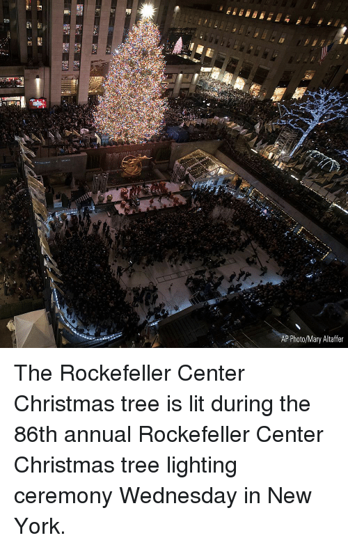 Christmas, Lit, and Memes: ca  AP Photo/Mary Altaffer The Rockefeller Center Christmas tree is lit during the 86th annual Rockefeller Center Christmas tree lighting ceremony Wednesday in New York.