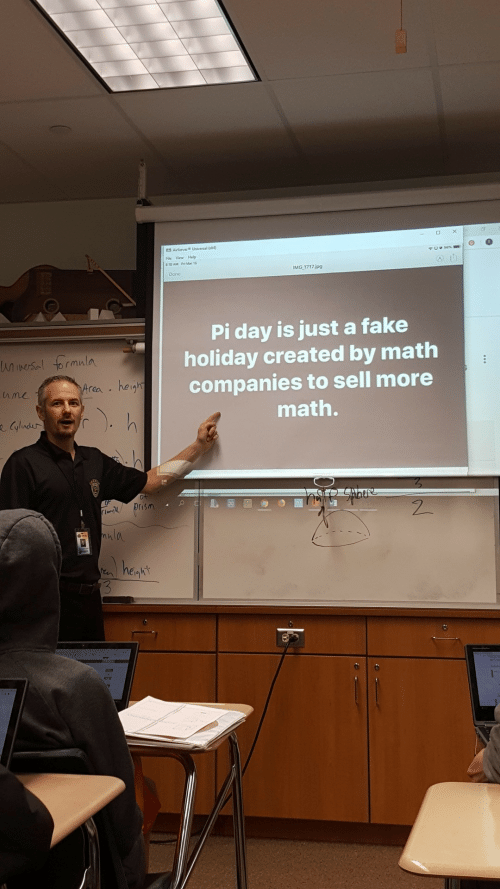 Fake, Help, and Math: File View Help  818 AM Fri Mar 15  IMG 1717.ipg  Done  Pi day is just a fake  holiday created by math  companies to sell more  math.  rea he  hmc  0