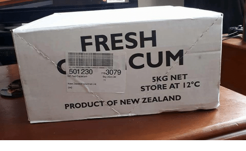 Cum, Fresh, and New Zealand: FRESH  CUM  501 230 3079  NZ Red Capsicum  5KG NET  STORE AT 12°C  T1  New Zealand Gourmet Ltd  040  PRODUCT OF NEW ZEALAND