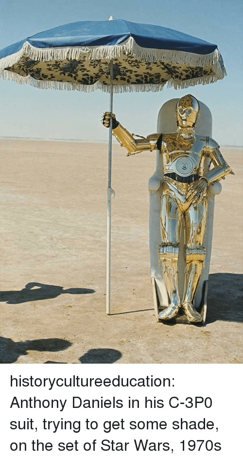 Shade, Star Wars, and Tumblr: historycultureeducation:  Anthony Daniels in his C-3P0 suit, trying to get some shade, on the set of Star Wars, 1970s