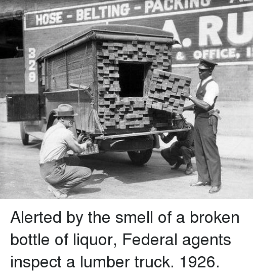 Smell, Office, and Truck: HOSE BELTING PACKINU  & OFFICE, Alerted by the smell of a broken bottle of liquor, Federal agents inspect a lumber truck. 1926.