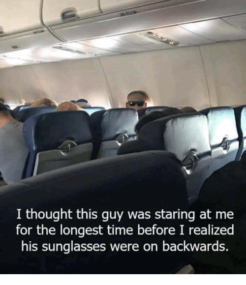 Sunglasses, Time, and Thought: I thought this guy was staring at me  for the longest time before I realized  his sunglasses were on backwards.