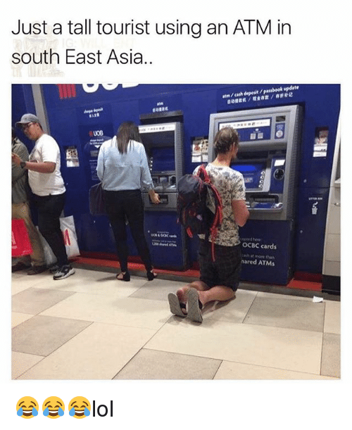 just a tall tourist using an atm in south east 27231241 just a tall tourist using an atm in south east asia atm cash