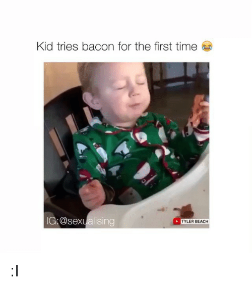 kid eating bacon for the first time