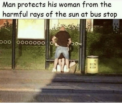 Sun, The Sun, and Bus: Man protects his woman from the  harmful rays of the sun at bus stop