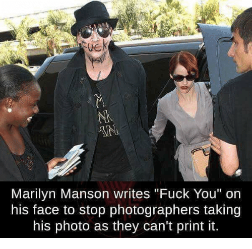 "Fuck You, Marilyn Manson, and Fuck: Marilyn Manson writes ""Fuck You"" on  his face to stop photographers taking  his photo as they can't print it."