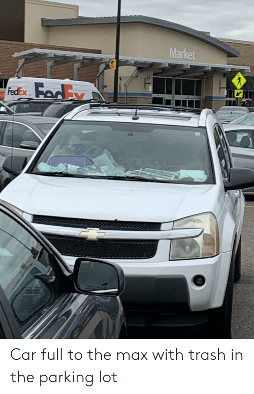 Trash, Fedex, and Car: Market  K  FedEx Car full to the max with trash in the parking lot