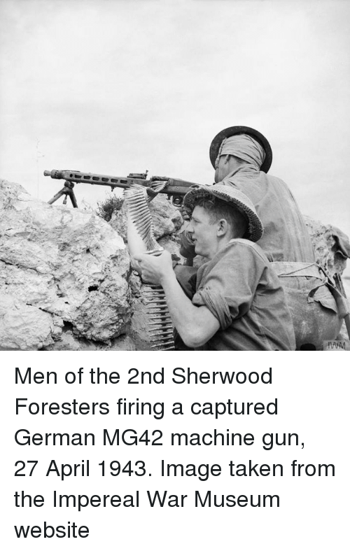 Men Of The 2nd Sherwood Foresters Firing A Captured German Mg42