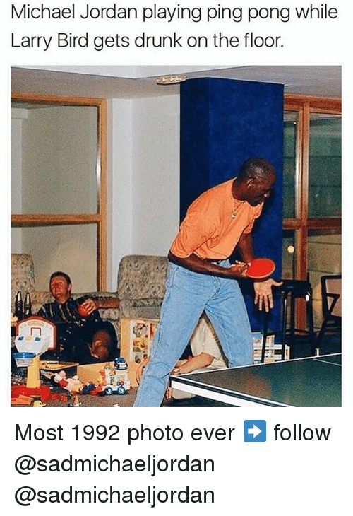 Drunk, Memes, and Michael Jordan: Michael Jordan playing ping pong while  Larry Bird gets drunk on the floor. Most 1992 photo ever ➡️ follow @sadmichaeljordan @sadmichaeljordan
