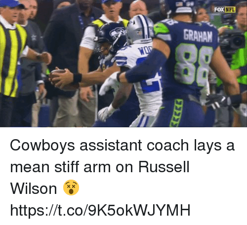 Sizzle: NFL  GRAHAM Cowboys assistant coach lays a mean stiff arm on Russell Wilson 😵  https://t.co/9K5okWJYMH