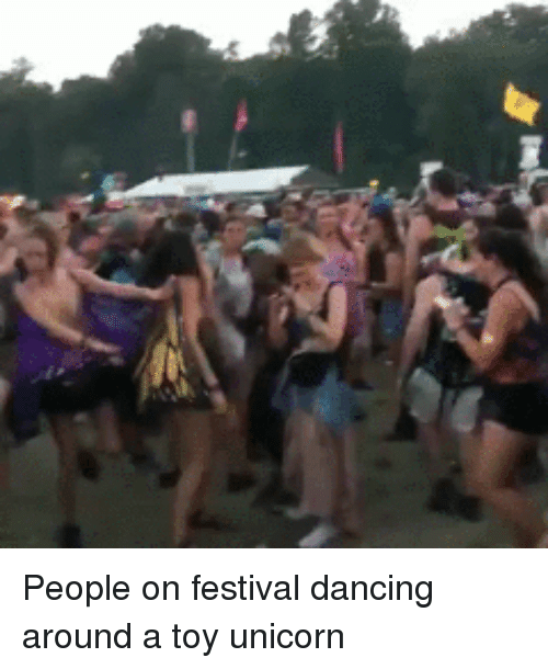 Crazy, Dancing, and Funny: People on festival dancing around a toy unicorn
