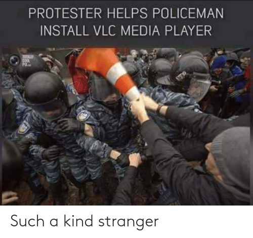 Helps, Media, and Player: PROTESTER HELPS POLICEMAN  INSTALL VLC MEDIA PLAYER Such a kind stranger