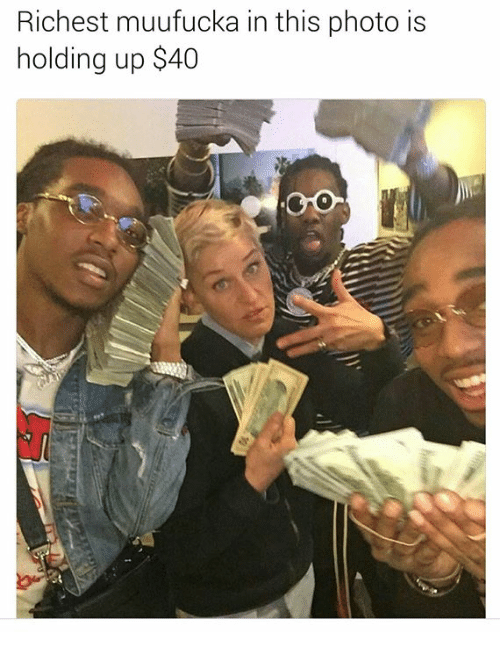 Photo, This, and Holding: Richest muufucka in this photo is  holding up $40