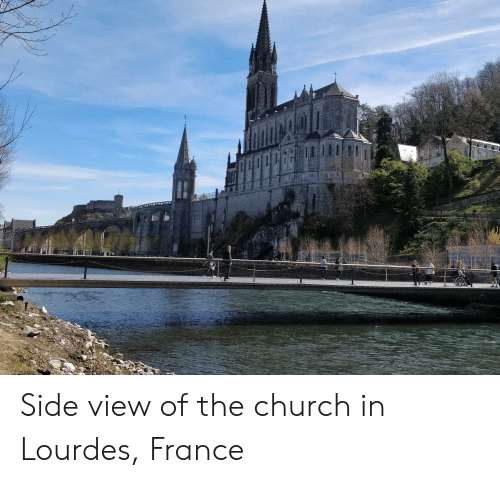 Church, France, and The Church: Side view of the church in Lourdes, France