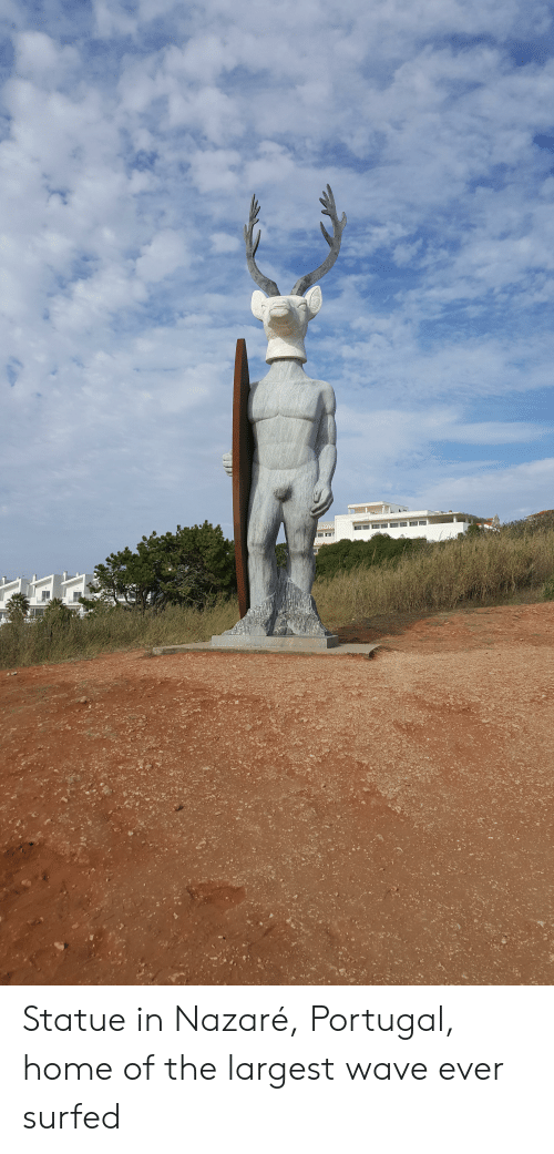 Home, Portugal, and Wave: Statue in Nazaré, Portugal, home of the largest wave ever surfed