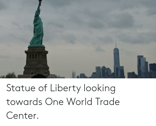 Statue of Liberty, World, and World Trade Center: Statue of Liberty looking towards One World Trade Center.