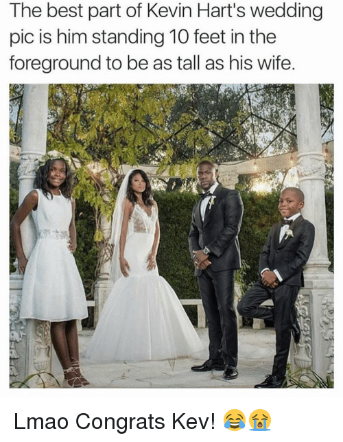 Memes, 🤖, and Feet: The best part of Kevin Hart's wedding  pic is him standing 10 feet in the  foreground to be as tall as his wife. Lmao Congrats Kev! 😂😭