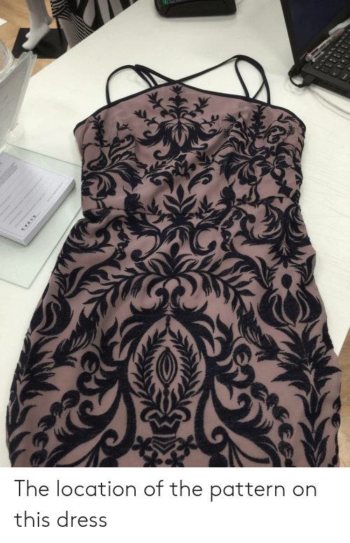 Dress, This, and  Pattern: The location of the pattern on this dress
