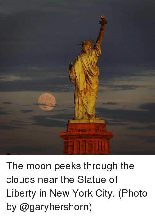 Liberty Near Me >> The Moon Peeks Through The Clouds Near The Statue Of Liberty