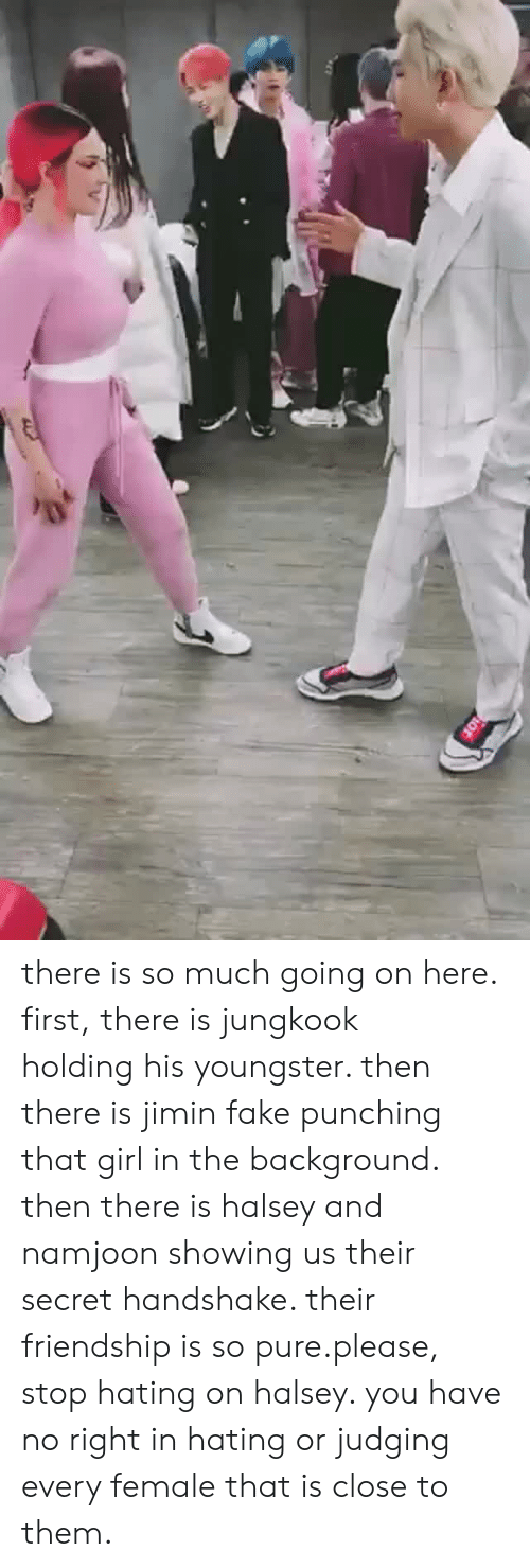 Fake, Girl, and Friendship: there is so much going on here. first, there is jungkook holding his youngster. then there is jimin fake punching that girl in the background. then there is halsey and namjoon showing us their secret handshake. their friendship is so pure.please, stop hating on halsey. you have no right in hating or judging every female that is close to them.