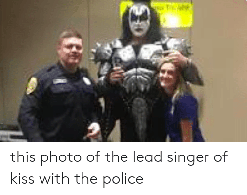 Police, Kiss, and Lead: this photo of the lead singer of kiss with the police