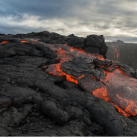"""Memes, 🤖, and Creation: <- Swipe to scroll thru images -> Massive amounts of molten lava have been flowing from the Kilauea Volcano in Hawaii for 34 years. Lava flows both above and below ground. Flow above ground, also known as surface flows, have been flowing intermittently since May 24, 2016. They have been named 61 G by Hawaiian Volcano Observatory geologists to distinguish this new flow episode. Lava from the Kilauea Volcano has to make quite a journey before reaching the ocean and forming new land. It travels 6.5 miles from the Puʻu ʻŌʻō lava vent to the sea cliff, then another another 4 miles down the cliff's slopes, and finally flows for 2.2 miles before it reaches it's final destination, the Pacific Ocean. Surface flows allow us to take a trip back in time and actually witness the creation of earth before our very eyes. Kupaianaha (awesome)!!! The lava that flows underground has consolidated into a single, subterranean tube and is flowing in a steady stream called a """"Lava Fall"""", or fire hose. These videos were filmed just this month, by Warren Fintz of Eppix Adventures. Thank you @eppixadventures for sharing these awesome images with the @science community!"""