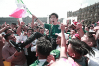 World Cup, Mexico, and World: <p>A group of Mexican fans carrying a South Korean fan after a South Korean win secures Mexico a spot in the knockout stage of the World Cup.</p>