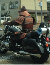 <p>A Samurai with his trusty motorcycle steed.</p>: <p>A Samurai with his trusty motorcycle steed.</p>