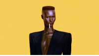 "80s, Black History Month, and Children: <p>Black history month day 15: Grace Jones</p>  <p>Grace Jones was born in Spanish Town, Jamaica in 1948. For some time during her early childhood, her parents left her and her siblings in the care of their maternal grandmother and her new husband while they moved to the States. Her step grandfather was a harsh disciplinarian and beat the children often. Jones later said this had a profound impact on her personality as an adult.</p>  <p>At 13 she moved back with her parents in New York and completed high school. As she enrolled in community college she began actively rebelling against her parents and their Pentecostal faith, immersing herself in the hippie counterculture of the 60s. At 18 she signed on as a model and moved to Paris. She found France to be quite receptive of her dark skin and bold appearance. During her modeling career she appeared on the covers of Elle, Vogue, and Stern. She also modelled for Azzedine Alaia.</p>  <p>In the 70s and 80s Jones transitioned her career to singing and acting. Her music inspired by things like island reggae and disco. In 2017 she collaborated with British virtual band Gorillaz, appearing on the song ""Charger"".</p>"