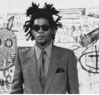 <p>Black history month day 18: Painter Jean-Michel Basquiat</p>  <p>Jean-Michel Basquiat was born in Brooklyn in 1960, shortly after the death of his elder brother, Max. His father was born in Port-au-Prince, Haiti and his mother was of Puerto Rican descent. His mother help instill a love for art at a young age my taking him to visit art museums in Manhattan and enrolling him as a junior member of the Brooklyn Museum of Art. Basquiat was a precocious child who learned how to read and write by age four and showed artistic ability. By the age of 11, he was fully fluent in French, Spanish and English.</p>  <p>Basquait dropped out of high school in 10th grade and was kicked out of the house by his father. He stayed with friends and attended an alternative school in New York City. He got by financially by selling T-shirts and homemade postcards. He got into graffiti with his friend and was discovered while spray painting buildings. He eventually got gallery space with art dealer Larry Gagosian, and for time he lived with Gagosian and his girlfriend, a then little known up-and-coming singer named Madonna.</p>  <p>Basquiat was known for his prolific, street artist style and sold paintings for upwards of $25,000. Unfortunately he died of a drug overdose at age 27.</p>: <p>Black history month day 18: Painter Jean-Michel Basquiat</p>  <p>Jean-Michel Basquiat was born in Brooklyn in 1960, shortly after the death of his elder brother, Max. His father was born in Port-au-Prince, Haiti and his mother was of Puerto Rican descent. His mother help instill a love for art at a young age my taking him to visit art museums in Manhattan and enrolling him as a junior member of the Brooklyn Museum of Art. Basquiat was a precocious child who learned how to read and write by age four and showed artistic ability. By the age of 11, he was fully fluent in French, Spanish and English.</p>  <p>Basquait dropped out of high school in 10th grade and was kicked out of the house by his father. He stayed with friends and attended an alternative school in New York City. He got by financially by selling T-shirts and homemade postcards. He got into graffiti with his friend and was discovered while spray painting buildings. He eventually got gallery space with art dealer Larry Gagosian, and for time he lived with Gagosian and his girlfriend, a then little known up-and-coming singer named Madonna.</p>  <p>Basquiat was known for his prolific, street artist style and sold paintings for upwards of $25,000. Unfortunately he died of a drug overdose at age 27.</p>