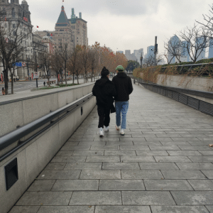 Gay couple in china, one (on the left) is wearing rainbow treaded shoes and they are walking with no fear.: 元江路  CHELOPH Gay couple in china, one (on the left) is wearing rainbow treaded shoes and they are walking with no fear.