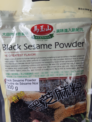 Food, Target, and Control: 請由此撕開  美味進入新紀元  大自然色食品  GREENMAX  SINCE 1961  OW  Black Sesame Powder  THE GREATEST FLAVOR!  Eating is a simple action to human beings but choosing something to eat becomes a hardest subject for  modern people. We not only sales products to customers but also provides delicious food to people  Rich in flavors and delicate natural food expand the outstanding target of new generation for the world  Perfectly balanced of combining nutritious and delicious. We take it for granted that strictiy select each  raw material and control quality for every single time. We concern what you care. We care what you  naven't aware. Take it, enjoy the best moment of lovely world. Be a chief at home easily and freely.  / HACCP ISO 9001 ISO 22000 ISO 14001 OHSAS 18001  taian/No Preservative /CERTIFIED BY HACCP ISO 9001 1SO 22000 ISO 14001 SHSAS 1800  Black Sesame Powder  Poudre de Sésame Noir OZ).  300 g  7AAY Philosophical