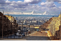 Memes, Streets, and 🤖: 씐  uiHBERL The Pyramids as seen from a Cairo street.