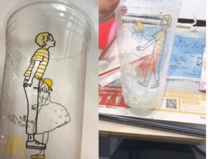 McFizz promotion cup in Japan is supposed to show a girl giving a boy a kiss on the cheek, but when viewed from a different angle..: 0  TE  56 McFizz promotion cup in Japan is supposed to show a girl giving a boy a kiss on the cheek, but when viewed from a different angle..