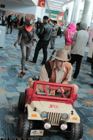 vantasticmess:  eveil:  nightkinks:  scribblescruff:  brandonchesnutt:  Amazing Jurassic Park cosplay. I'm dying. Via Gamma Squad.   omg the video of them going around the con is HILARIOUS  Go faster. Must go faster.  This is the true spirit of cosplay a full grown man riding in a Power Wheel modified to look like a Jurassic Park truck with a lady in a raptor suit chasing him all over the convention everyone else go home. : 010  JPT  David Nao for GFBRobot com vantasticmess:  eveil:  nightkinks:  scribblescruff:  brandonchesnutt:  Amazing Jurassic Park cosplay. I'm dying. Via Gamma Squad.   omg the video of them going around the con is HILARIOUS  Go faster. Must go faster.  This is the true spirit of cosplay a full grown man riding in a Power Wheel modified to look like a Jurassic Park truck with a lady in a raptor suit chasing him all over the convention everyone else go home.
