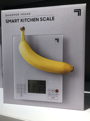 Banana for Scale: 1  SHARPER IMAGE  SMART KITCHEN SCALE  2.00  338 CAL 110  1.0  0Z  WT  FOOD  CODE  1  2  3  mgPROT  SALT  CLFAT  10  0.4  5 6  ARB  OFF  ZERO  ON  21.0 0.0  3.1  7 8  UNIT  M+  MR  0  CLR/MC Banana for Scale