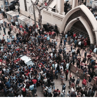 Church, Memes, and Delta: -1  TT Relatives and onlookers swarm around a car outside a church after a bomb attack in the Nile Delta town of Tanta, Egypt. (Photo credit: Associated Press)